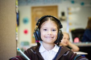 Pupil with headphones on